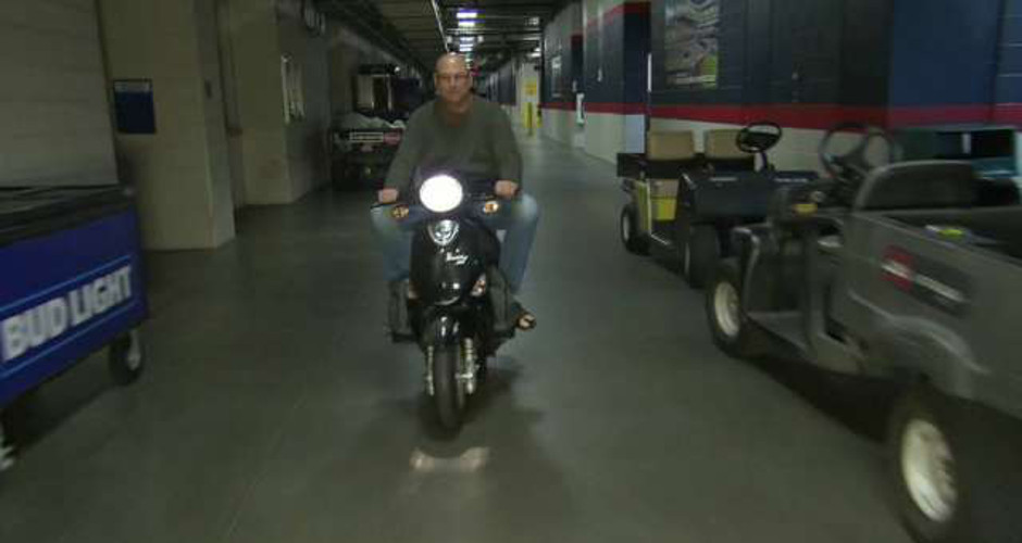 Cleveland Indians Manager Terry Francona rides Buddy scooter to work